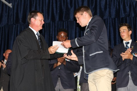 David Rushmere receives his honours award from St Andrew's College headmaster,  Alan Thompson.