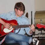 Student playing guitar - St Andrew's College